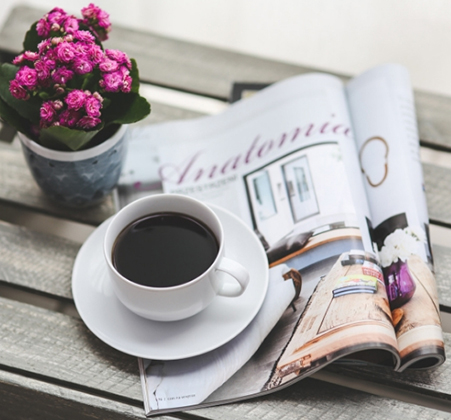 Open magazine with coffee cup