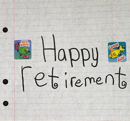 Notebook paper with words Happy Retirement