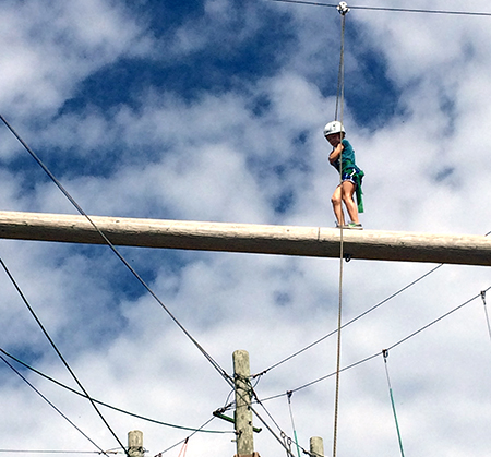 Student on Adventure Ropes Course wire