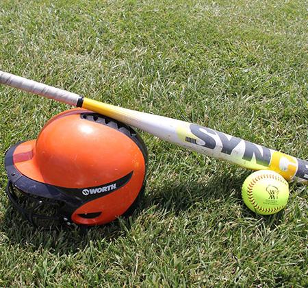 helmet, bat, ball on field