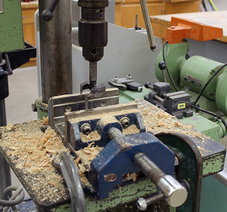 Drill press with sawdust