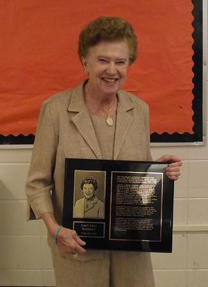 Carol Edler Baumann with plaque